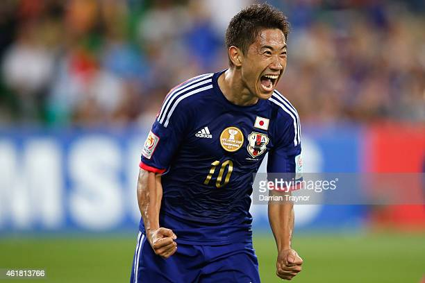 Shinji Kagawa of Japan reacts after scoring a goal during the 2015 Asian Cup match between Japan and Jordan at AAMI Park on January 20 2015 in...