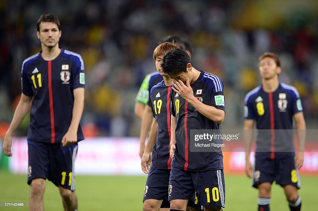 Shinji Kagawa of Japan reacts as he walks off of the pitch with his team after losing to Mexico by a score of 2-1 during the FIFA Confederations Cup Brazil 2013 Group A match between Japan and Mexico at Estadio Mineirao on June 22, 2013 in Belo Horizonte, Brazil.