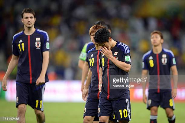 Shinji Kagawa of Japan reacts as he walks off of the pitch with his team after losing to Mexico by a score of 21 during the FIFA Confederations Cup...