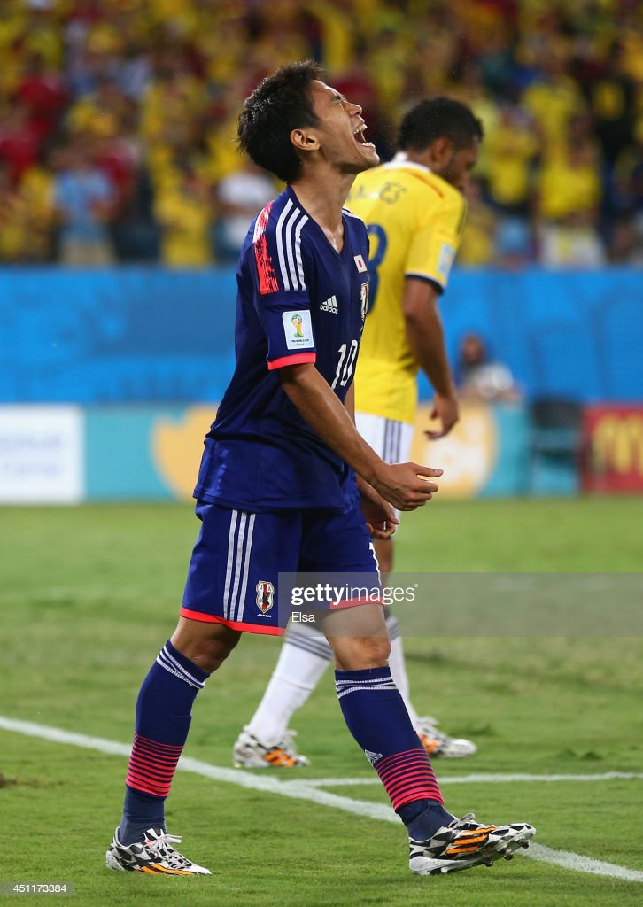 Shinji Kagawa of Japan reacts during the 2014 FIFA World Cup Brazil Group C match between Japan and Colombia at Arena Pantanal on June 24 2014 in...