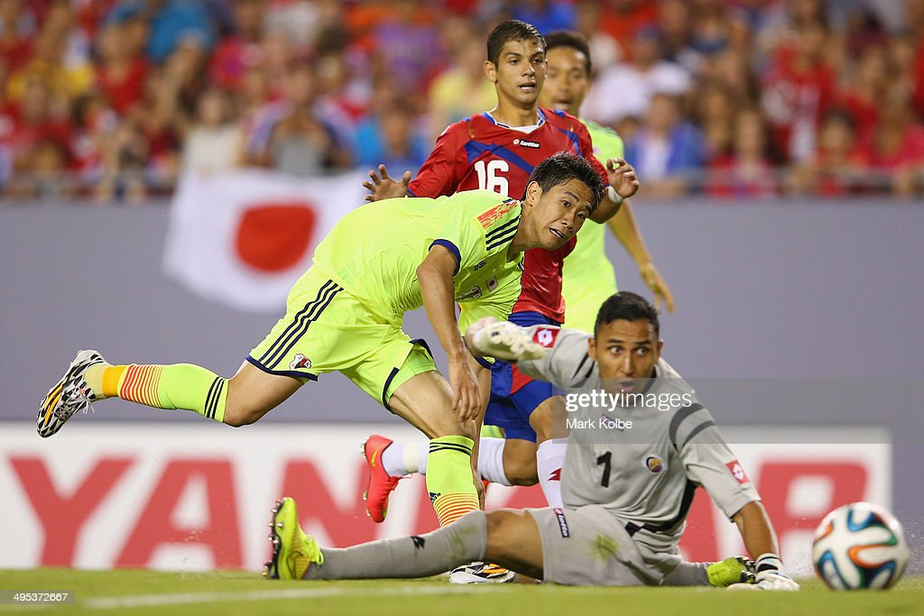 <a gi-track='captionPersonalityLinkClicked' href=/galleries/search?phrase=Shinji+Kagawa&family=editorial&specificpeople=4314029 ng-click='$event.stopPropagation()'>Shinji Kagawa</a> of Japan scores a goal during the International Friendly Match between Japan and Costa Rica at Raymond James Stadium on June 2, 2014 in Tampa, Florida.