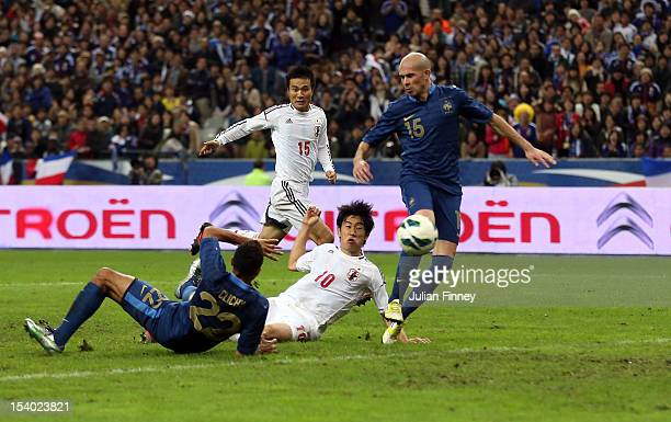 Shinji Kagawa of Japan scores the winning goal as Gael Clichy and Christophe Jallet of France fail to stop during the International Friendly match...