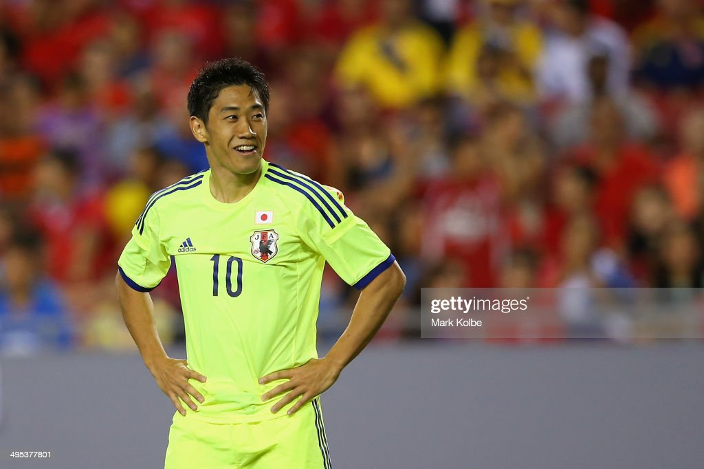 <a gi-track='captionPersonalityLinkClicked' href=/galleries/search?phrase=Shinji+Kagawa&family=editorial&specificpeople=4314029 ng-click='$event.stopPropagation()'>Shinji Kagawa</a> of Japan smiles during the International Friendly Match between Japan and Costa Rica at Raymond James Stadium on June 2, 2014 in Tampa, Florida.