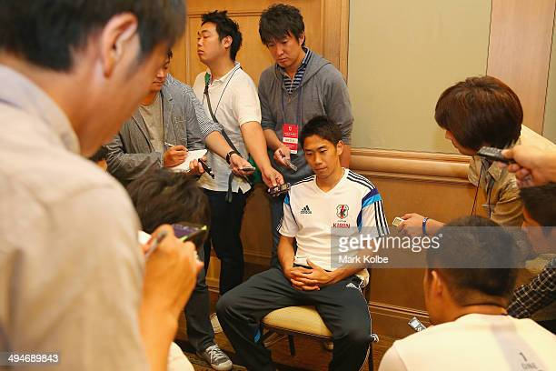Shinji Kagawa of Japan speaks to the press during a media session at the Hyatt Regency Clearwater Beach Resort and Spa on May 30 2014 in Clearwater...