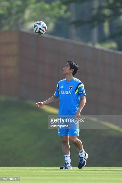 Shinji Kagawa of Japan warms up during the training session on May 21 2014 in Ibusuki Kagoshima Japan