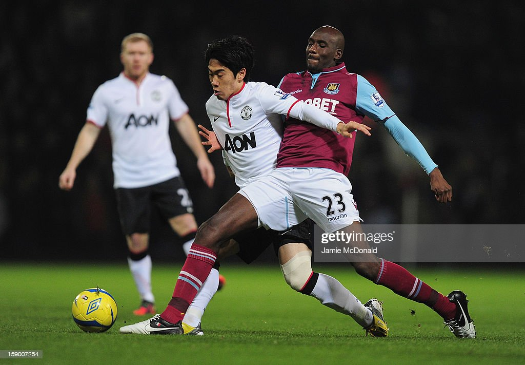 Shinji Kagawa of Manchester United and Alou Diarra of West Ham United tussle for the ball during the FA Cup with Budweiser Third Round match between West Ham United and Manchester United at the Boleyn Ground on January 5, 2013 in London, England.