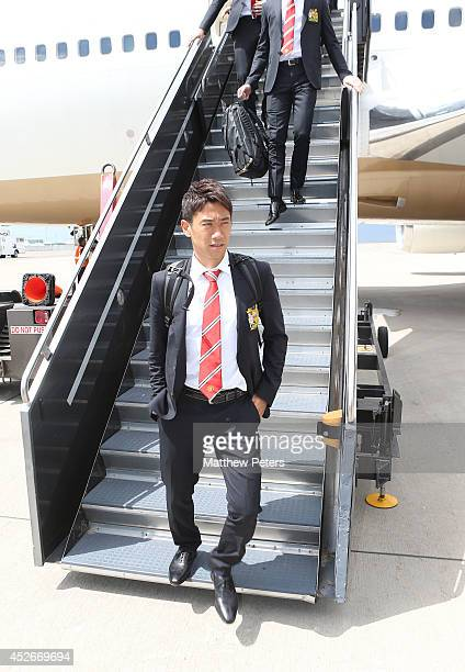 Shinji Kagawa of Manchester United arrives in Denver as part of their preseason tour of the United States on July 24 2014 at Sports Authority Field...