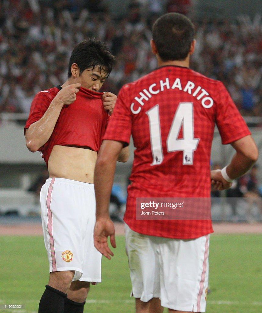 Shinji Kagawa of Manchester United celebrates scoring their first goal during the preseason friendly match between Shanghai Shenhua and Manchester...