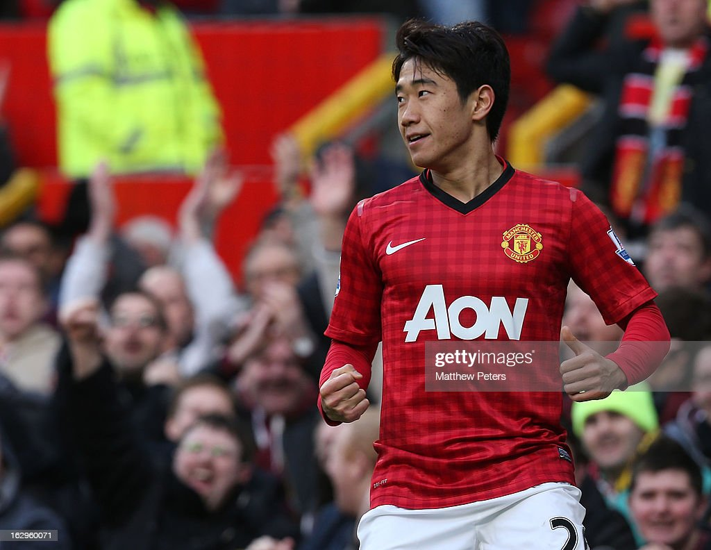 <a gi-track='captionPersonalityLinkClicked' href=/galleries/search?phrase=Shinji+Kagawa&family=editorial&specificpeople=4314029 ng-click='$event.stopPropagation()'>Shinji Kagawa</a> of Manchester United celebrates scoring their third goal during the Barclays Premier League match between Manchester United and Norwich City at Old Trafford on March 2, 2013 in Manchester, England.