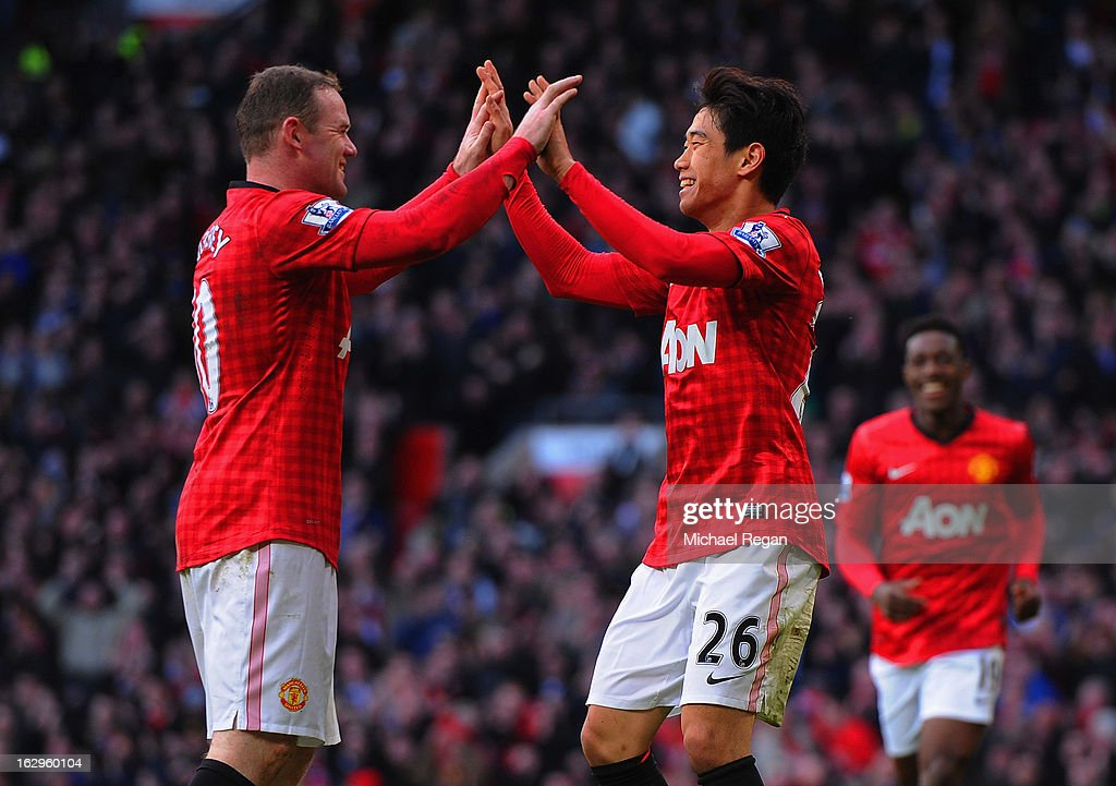<a gi-track='captionPersonalityLinkClicked' href=/galleries/search?phrase=Shinji+Kagawa&family=editorial&specificpeople=4314029 ng-click='$event.stopPropagation()'>Shinji Kagawa</a> of Manchester United celebrates scoring to make it 2-0 with team mate <a gi-track='captionPersonalityLinkClicked' href=/galleries/search?phrase=Wayne+Rooney&family=editorial&specificpeople=157598 ng-click='$event.stopPropagation()'>Wayne Rooney</a> during the Barclays Premier League match between Manchester United and Norwich City at Old Trafford on March 2, 2013 in Manchester, England.