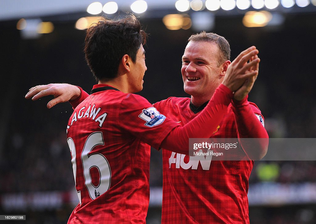 <a gi-track='captionPersonalityLinkClicked' href=/galleries/search?phrase=Shinji+Kagawa&family=editorial&specificpeople=4314029 ng-click='$event.stopPropagation()'>Shinji Kagawa</a> of Manchester United celebrates scoring to make it 3-0 with team mate and claim a hat-trick with team mate <a gi-track='captionPersonalityLinkClicked' href=/galleries/search?phrase=Wayne+Rooney&family=editorial&specificpeople=157598 ng-click='$event.stopPropagation()'>Wayne Rooney</a> during the Barclays Premier League match between Manchester United and Norwich City at Old Trafford on March 2, 2013 in Manchester, England.