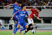 Shinji Kagawa of Manchester United challenges with Zheng Kaimu and Xiong Fei of Shanghai Shenhua during the Friendly Match between Shanghai Shenhua...