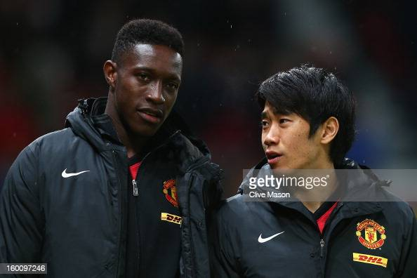 Shinji Kagawa of Manchester United chats to teammate Danny Welbeck prior to the FA Cup with Budweiser Fourth Round match between Manchester United...