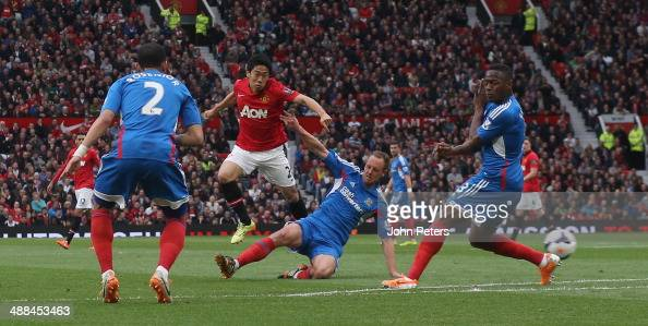 Shinji Kagawa of Manchester United has a shot on goal during the Barclays Premier League match between Manchester United and Hull City at Old...