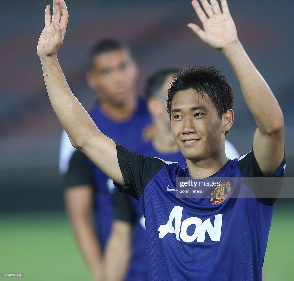 <a gi-track='captionPersonalityLinkClicked' href=/galleries/search?phrase=Shinji+Kagawa&family=editorial&specificpeople=4314029 ng-click='$event.stopPropagation()'>Shinji Kagawa</a> of Manchester United in action during a first team training session as part of their pre-season tour of Bangkok, Australia, China, Japan and Hong Kong on July 22, 2013 in Yokohama, Japan.
