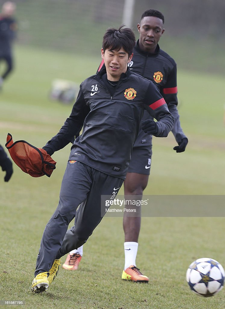 Shinji Kagawa of Manchester United in action during a first team training session, ahead of their UEFA Champions League Round of 16 match against Real Madrid, at Carrington Training Ground on February 12, 2013 in Manchester, England.