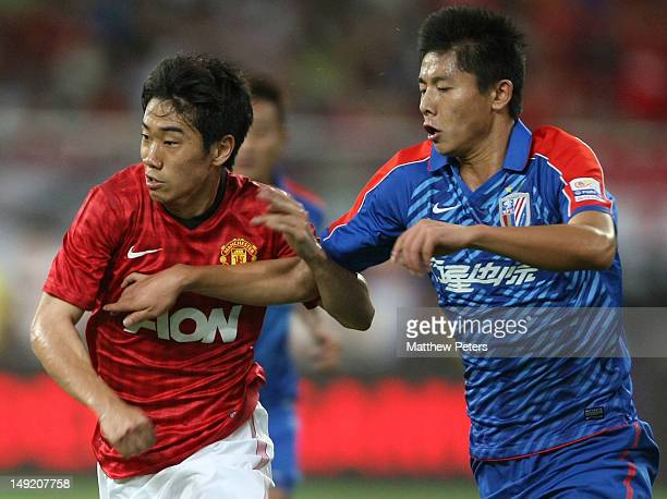Shinji Kagawa of Manchester United in action during the preseason friendly match between Shanghai Shenhua and Manchester United at Shanghai Stadium...