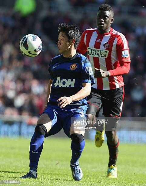 Shinji Kagawa of Manchester United in action with Alfred N'Diaye of Sunderland during the Barclays Premier League match between Sunderland and...