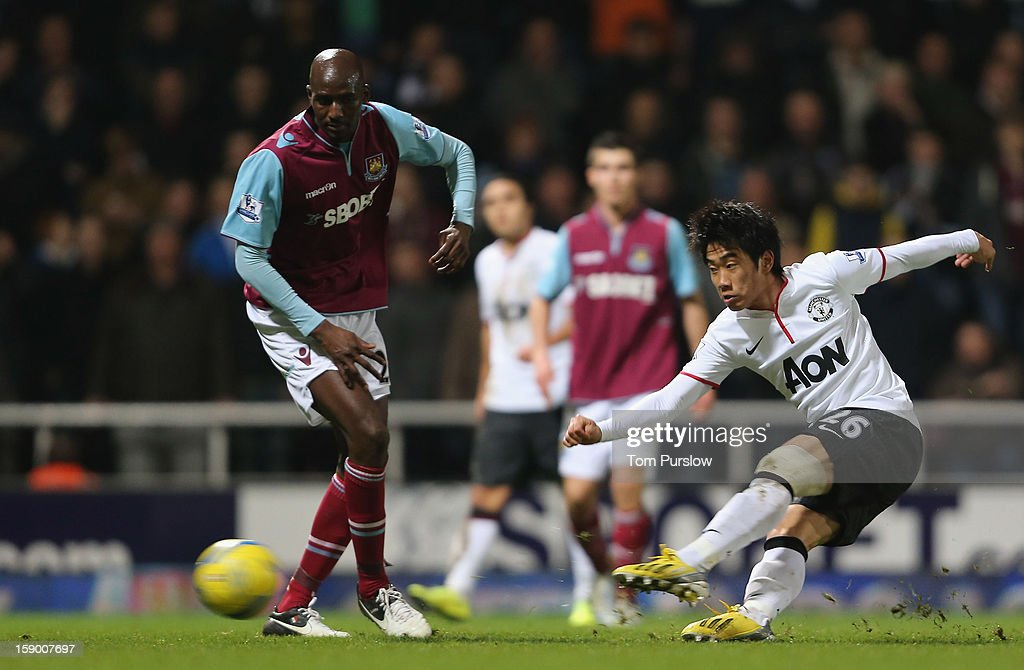 Shinji Kagawa of Manchester United in action with Alou Diarra of West Ham United during the FA Cup Third Round match between West Ham United and Manchester United at Boleyn Ground on January 5, 2013 in London, England.