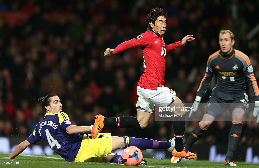 Shinji Kagawa of Manchester United in action with Chico Flores of Swansea City during the FA Cup Third Round match between Manchester United and...