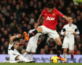 Shinji Kagawa of Manchester United in action with Chico Flores of Swansea City during the Barclays Premier League match between Manchester United and...