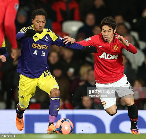 Shinji Kagawa of Manchester United in action with Jonathan de Guzman of Swansea City during the FA Cup Third Round match between Manchester United...