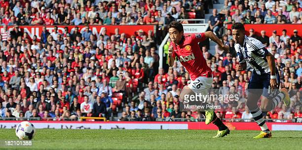 Shinji Kagawa of Manchester United in action with Scott Sinclair of West Bromwich Albion during the Barclays Premier League match between Manchester...