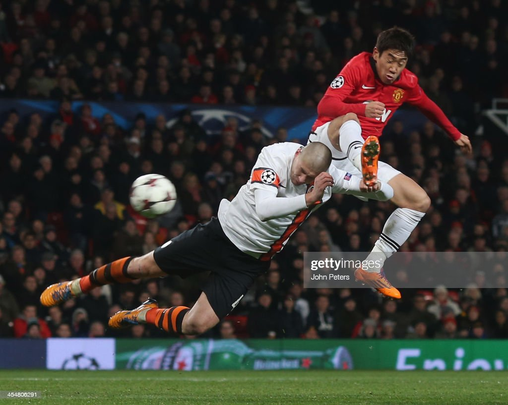 <a gi-track='captionPersonalityLinkClicked' href=/galleries/search?phrase=Shinji+Kagawa&family=editorial&specificpeople=4314029 ng-click='$event.stopPropagation()'>Shinji Kagawa</a> of Manchester United in action with <a gi-track='captionPersonalityLinkClicked' href=/galleries/search?phrase=Yaroslav+Rakitskiy&family=editorial&specificpeople=6565975 ng-click='$event.stopPropagation()'>Yaroslav Rakitskiy</a> of Shakhtar Donetsk during the UEFA Champions League Group A match between Manchester United and Shakhtar Donetsk at Old Trafford on December 10, 2013 in Manchester, England.