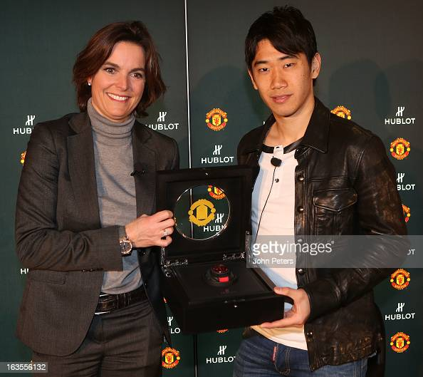 Shinji Kagawa of Manchester United is presented with a Hublot watch by Valerie Servageon Grande of Hublot watches before taking part in a charity...