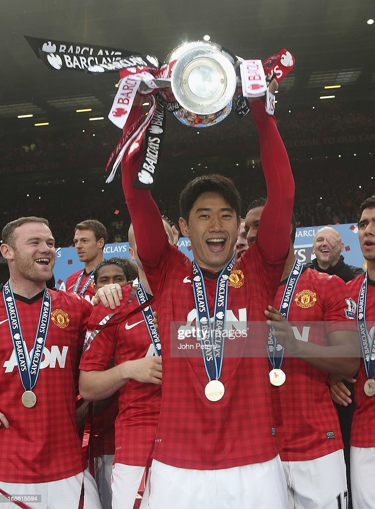 Shinji Kagawa of Manchester United lifts the Premier League trophy after the Barclays Premier League match between Manchester United and Swansea at Old Trafford on May 12, 2013 in Manchester, England.