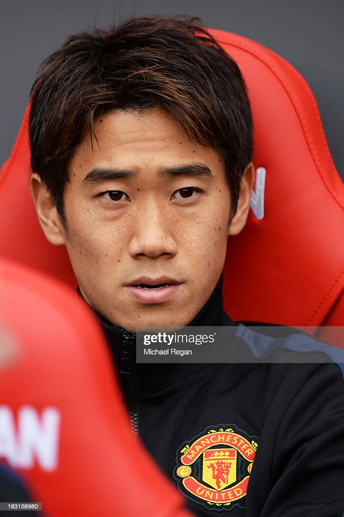Shinji Kagawa of Manchester United looks on from the bench prior to the Barclays Premier League match between Sunderland and Manchester United at the Stadium of Light on October 5, 2013 in Sunderland, England.
