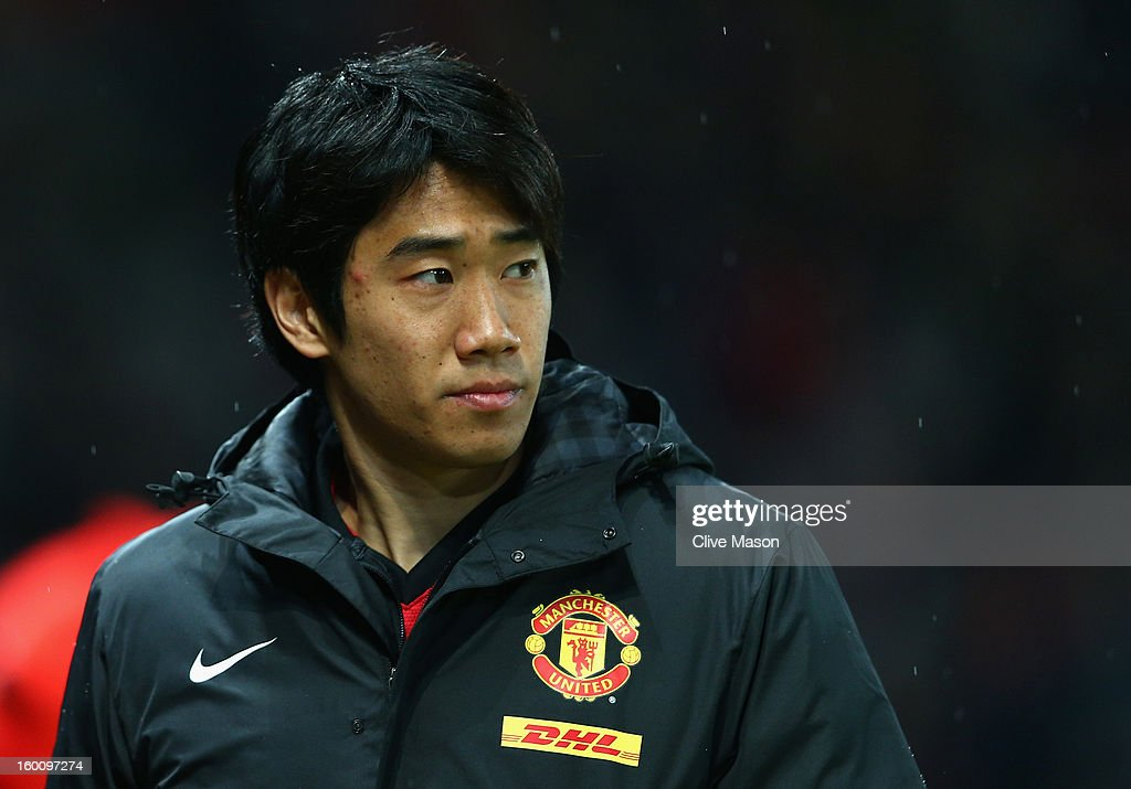 Shinji Kagawa of Manchester United looks on prior to the FA Cup with Budweiser Fourth Round match between Manchester United and Fulham at Old Trafford on January 26, 2013 in Manchester, England.