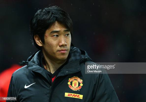 Shinji Kagawa of Manchester United looks on prior to the FA Cup with Budweiser Fourth Round match between Manchester United and Fulham at Old...