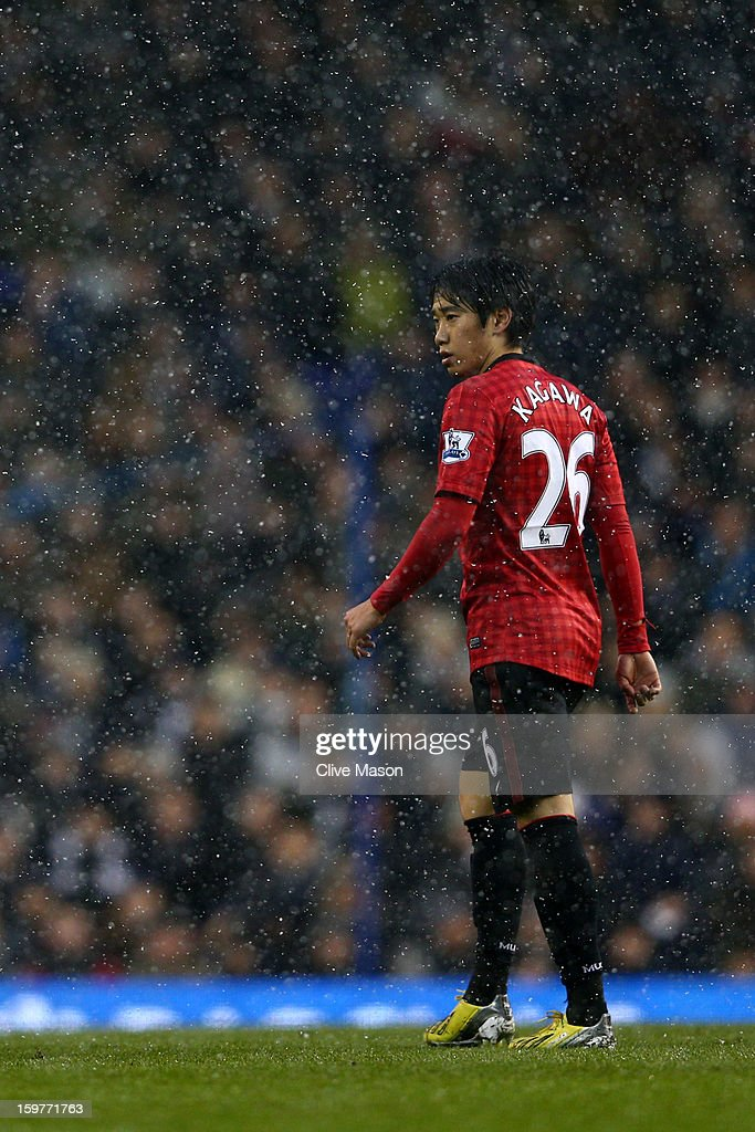 Shinji Kagawa of Manchester United looks on through the snow during the Barclays Premier League match between Tottenham Hotspur and Manchester United at White Hart Lane on January 20, 2013 in London, England.