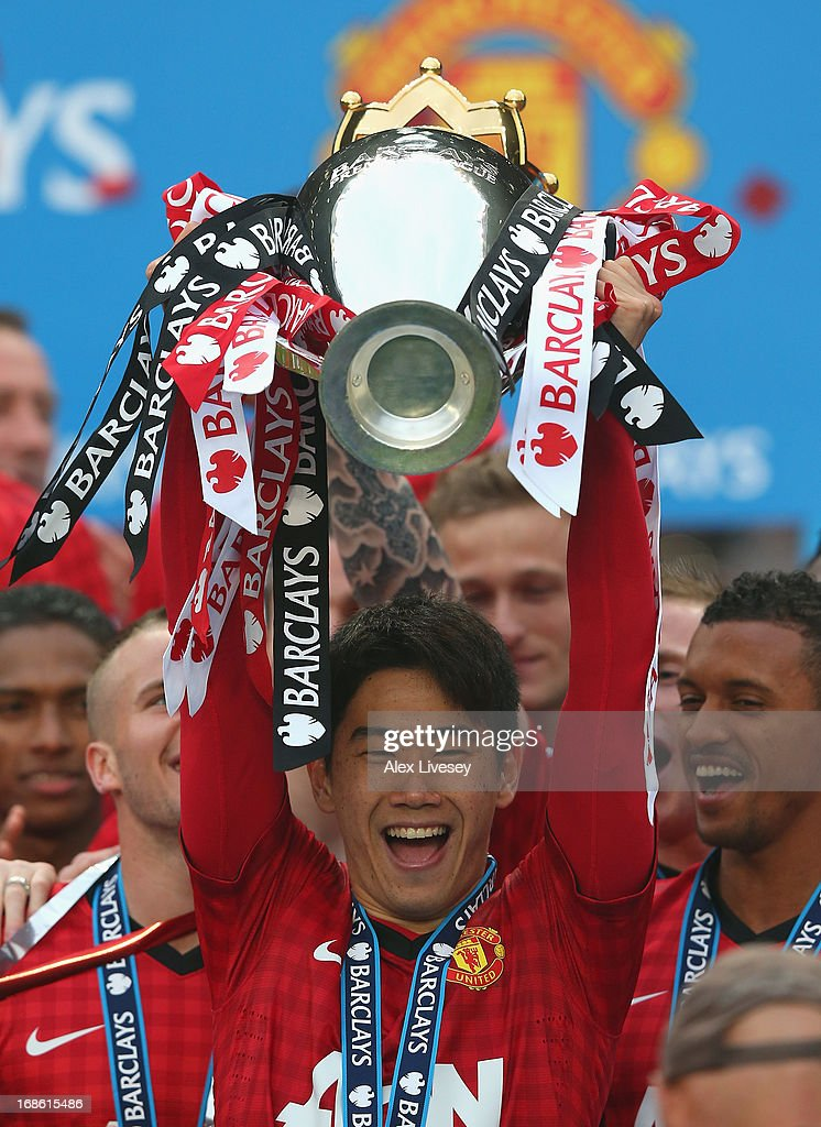 Shinji Kagawa of Manchester United of Manchester United lifts the Premier League trophy following the Barclays Premier League match between Manchester United and Swansea City at Old Trafford on May 12, 2013 in Manchester, England.