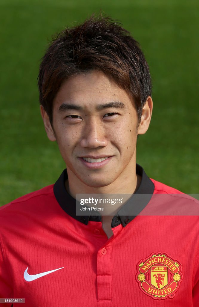 <a gi-track='captionPersonalityLinkClicked' href=/galleries/search?phrase=Shinji+Kagawa&family=editorial&specificpeople=4314029 ng-click='$event.stopPropagation()'>Shinji Kagawa</a> of Manchester United poses at the annual club photocall at Old Trafford on September 26, 2013 in Manchester, England.