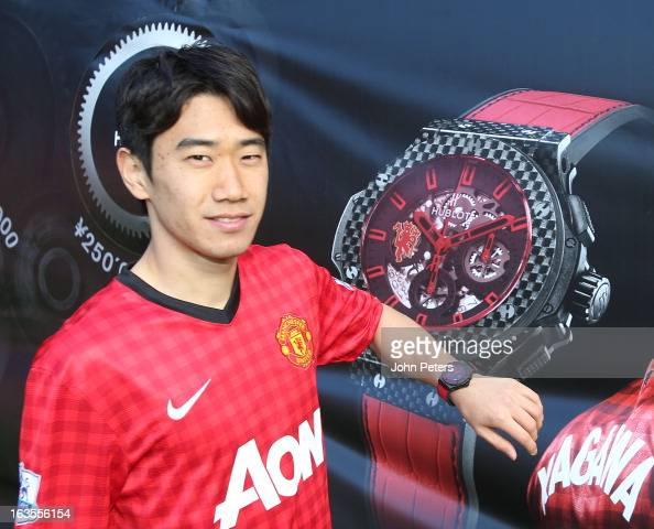 Shinji Kagawa of Manchester United poses with a Hublot watch after taking part in a charity shooting event at Old Trafford on March 12 2013 in...