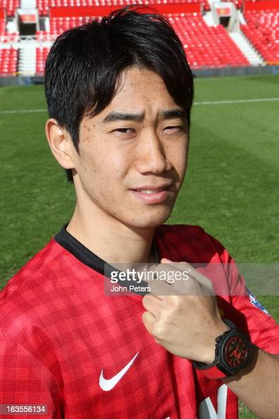 Shinji Kagawa of Manchester United poses with a Hublot watch before taking part in a charity shooting event at Old Trafford on March 12 2013 in...