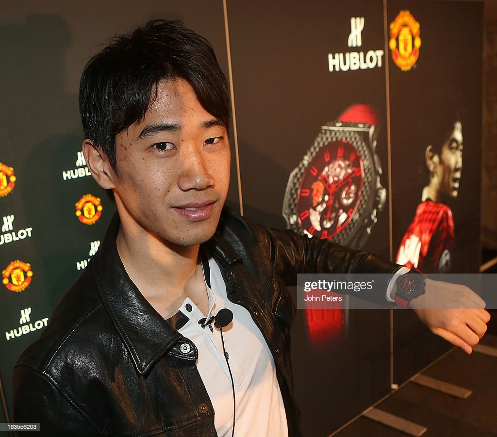 <a gi-track='captionPersonalityLinkClicked' href=/galleries/search?phrase=Shinji+Kagawa&family=editorial&specificpeople=4314029 ng-click='$event.stopPropagation()'>Shinji Kagawa</a> of Manchester United poses with a Hublot watch before taking part in a charity shooting event at Old Trafford on March 12, 2013 in Manchester, England.