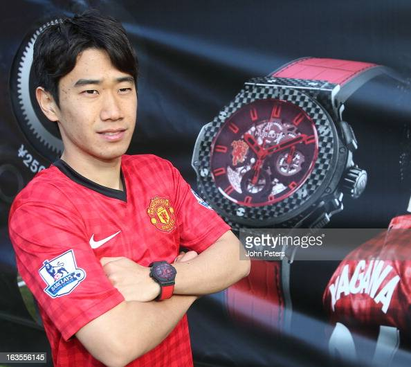 Shinji Kagawa of Manchester United poses with his Hublot limited edition watch after taking part in a charity shooting event at Old Trafford on March...