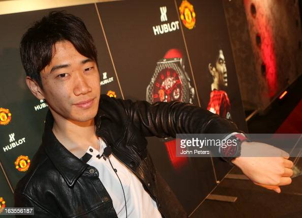 Shinji Kagawa of Manchester United poses with his Hublot limited edition watch before taking part in a charity shooting event at Old Trafford on...