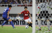 Shinji Kagawa of Manchester United prepares to shoot during the Friendly Match between Shanghai Shenhua and Manchester United at Shanghai Stadium on...