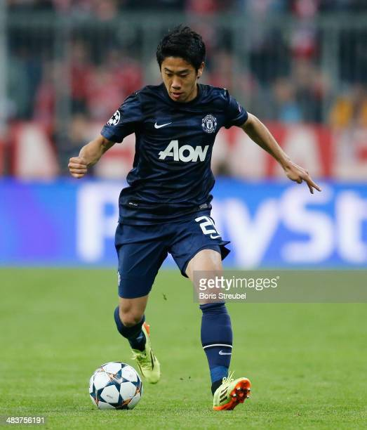 Shinji Kagawa of Manchester United runs with the ball during the UEFA Champions League Quarter Final second leg match between FC Bayern Muenchen and...