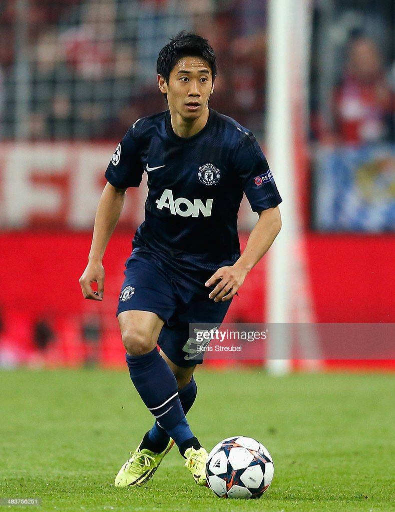 Shinji Kagawa of Manchester United runs with the ball during the UEFA Champions League Quarter Final second leg match between FC Bayern Muenchen and Manchester United at Allianz Arena on April 9, 2014 in Munich, Germany.