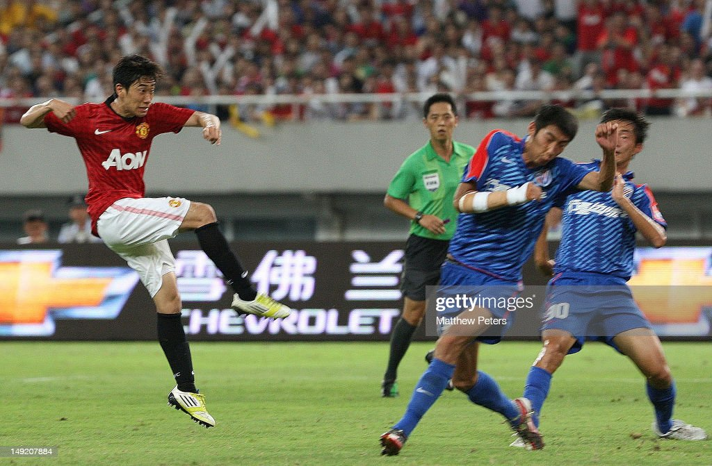 Shinji Kagawa of Manchester United scores their first goal during the preseason friendly match between Shanghai Shenhua and Manchester United at...