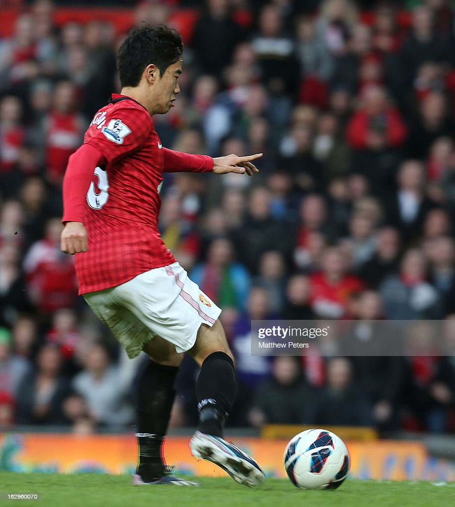 <a gi-track='captionPersonalityLinkClicked' href=/galleries/search?phrase=Shinji+Kagawa&family=editorial&specificpeople=4314029 ng-click='$event.stopPropagation()'>Shinji Kagawa</a> of Manchester United scores their third goal during the Barclays Premier League match between Manchester United and Norwich City at Old Trafford on March 2, 2013 in Manchester, England.