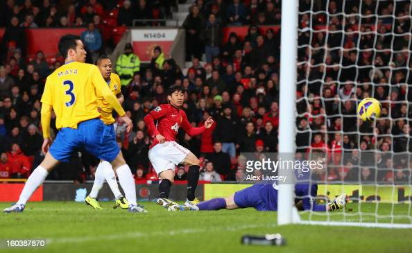 Shinji Kagawa of Manchester United shoots past Artur Boruc of Southampton but hits the post during the Barclays Premier League match between...