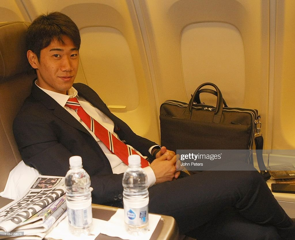 <a gi-track='captionPersonalityLinkClicked' href=/galleries/search?phrase=Shinji+Kagawa&family=editorial&specificpeople=4314029 ng-click='$event.stopPropagation()'>Shinji Kagawa</a> of Manchester United sits on the plane ahead of the club's pre-season tour of South Africa and China at Manchester Airport on July 16, 2012 in Manchester, England.