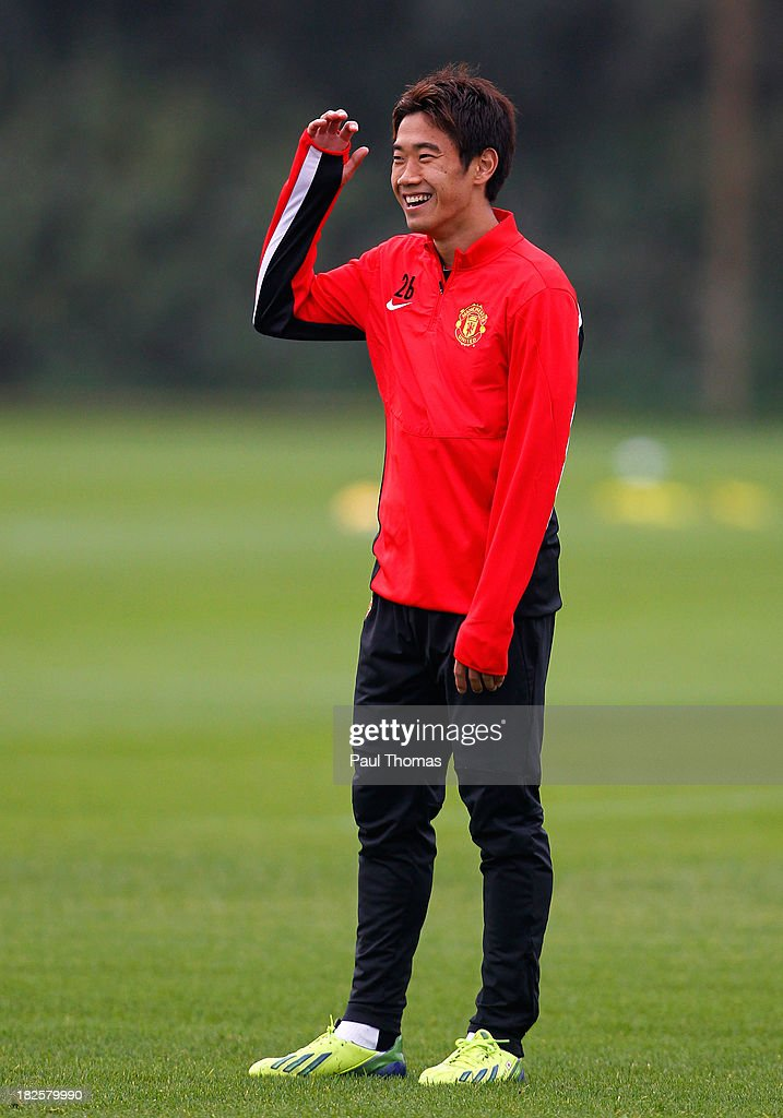 Shinji Kagawa of Manchester United smiles during a training session ahead of their Champions League Group A match against Shakhtar Donetsk at their Carrington Training Complex on October 01, 2013 in Manchester, England