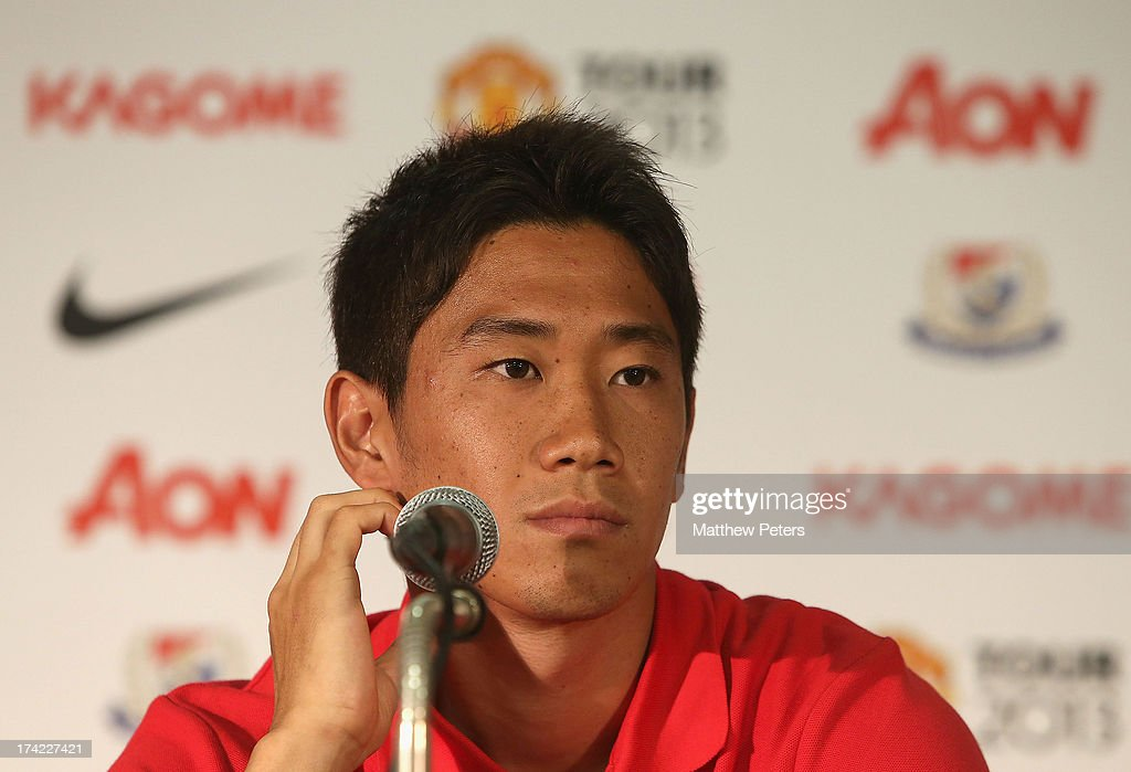 <a gi-track='captionPersonalityLinkClicked' href=/galleries/search?phrase=Shinji+Kagawa&family=editorial&specificpeople=4314029 ng-click='$event.stopPropagation()'>Shinji Kagawa</a> of Manchester United speaks during a press conference as part of their pre-season tour of Bangkok, Australia, China, Japan and Hong Kong on July 22, 2013 in Yokohama, Japan.